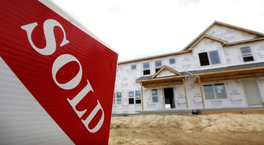 A sold sign stands in front of a home under construction in West Des Moines, Iowa, in June 27, 2018. Sales of new U.S. homes fell 5.5 percent in September amid higher borrowing costs.