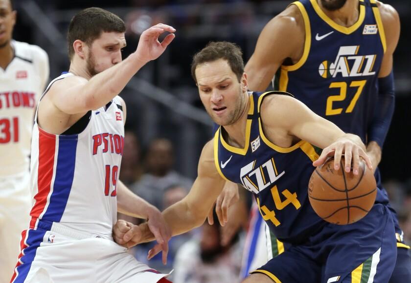 Utah Jazz forward Bojan Bogdanovic (44) drives against Detroit Pistons guard Sviatoslav Mykhailiuk (19) during the first half of an NBA basketball game Saturday, March 7, 2020, in Detroit. (AP Photo/Duane Burleson)