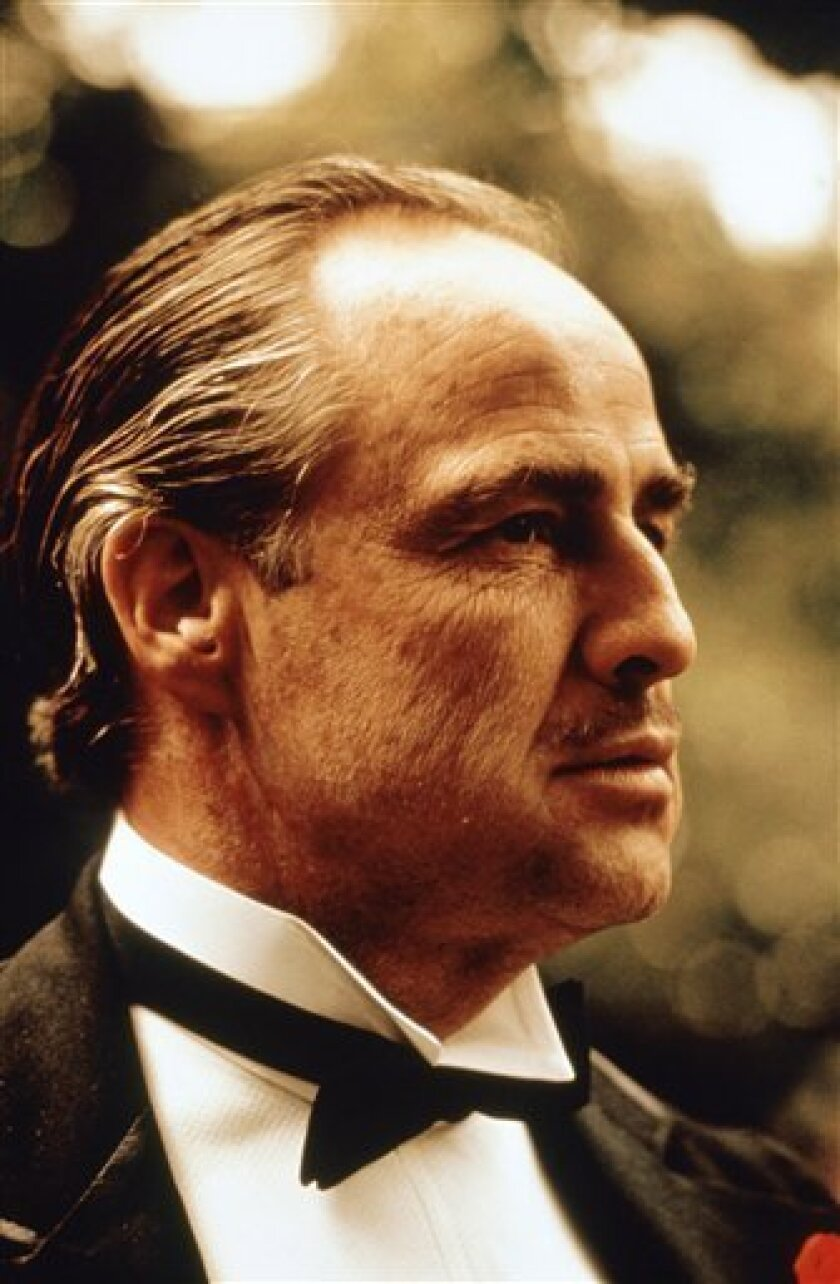 """FILE -  In this undated file photo provided by Paramount Pictures, Marlon Brando is shown in a scene from Paramount Pictures """"The Godfather,"""" in this undated promotional photo. (AP Photo/Paramount Pictures, file)"""