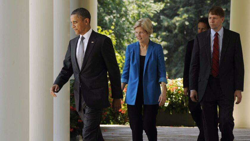 Then-President Obama leads Elizabeth Warren and Richard Cordray to the White House Rose Garden in 2011 to announce Cordray's nomination to be the first director of the Consumer Financial Protection Bureau