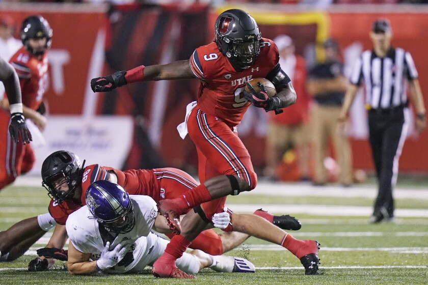 Utah running back Tavion Thomas carries the ball during the second half against Weber State.