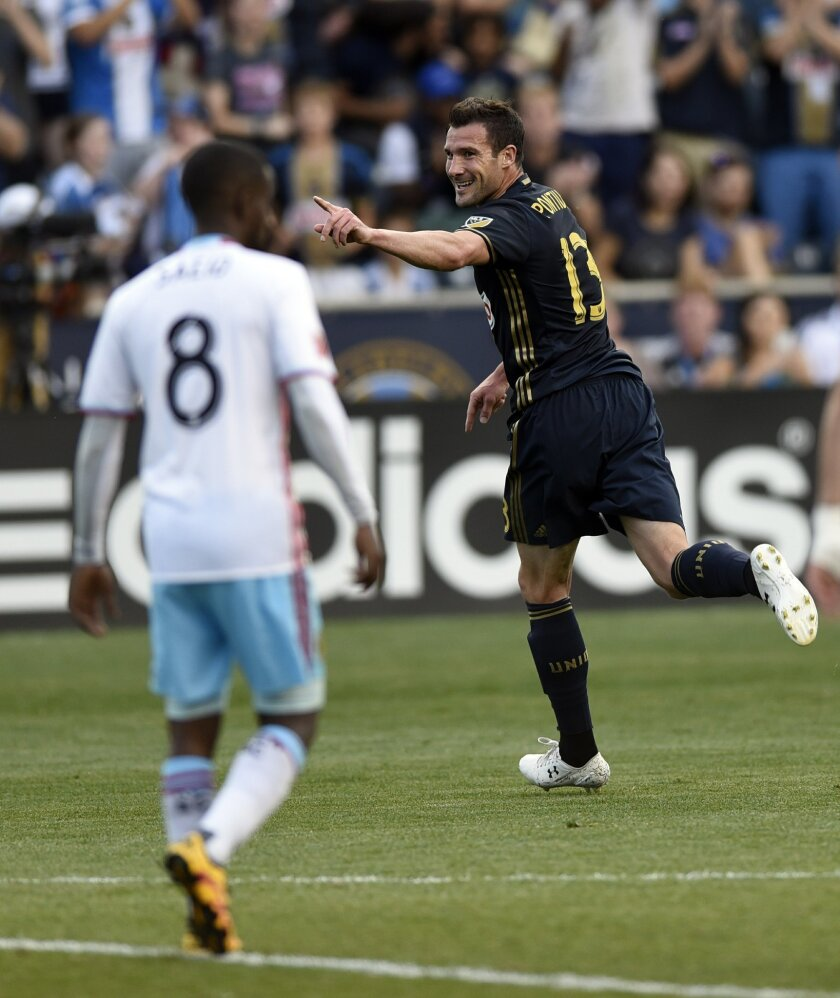 Philadelphia Union's Michael Lahoud (13) celebrates in front of Columbus Crew's Mohammed Saeid after scoring a goal in the first half of an MLS soccer match on Wednesday, June 1, 2016, in Chester, Pa. (AP Photo/Michael Perez)