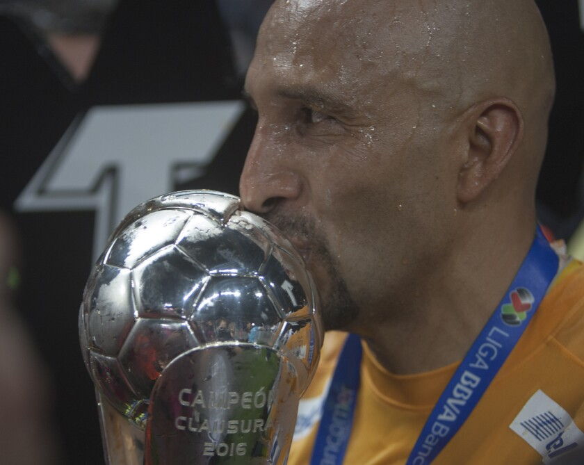 Pachuca's goalkeeper Oscar Perez kisses the trophy after defeating Monterrey during their Mexican Clausura 2016 tournament football final match at the BBVA stadium in Monterrey, Mexico on May, 29, 2016. / AFP PHOTO / Julio Cesar Aguilar FuentesJULIO CESAR AGUILAR FUENTES/AFP/Getty Images ** OUTS - ELSENT, FPG, CM - OUTS * NM, PH, VA if sourced by CT, LA or MoD **