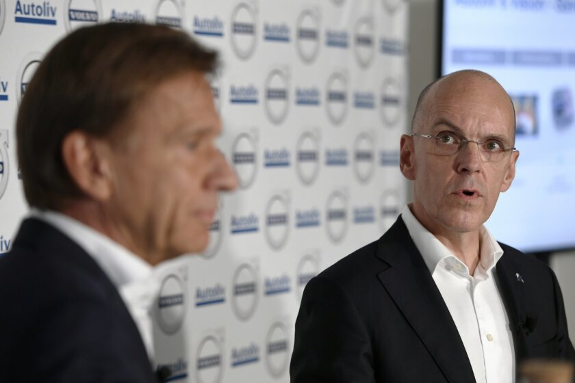 Hakan Samuelsson, left, MD Volvo Cars Group, and Jan Carlson, MD Autoliv, speak during a press conference in Stockholm, Sweden, Tuesday Sept. 6, 2016. Chinese-owned Volvo Cars and Sweden-based automotive safety group Autoliv say they are creating a jointly-owned company to develop autonomous drivin