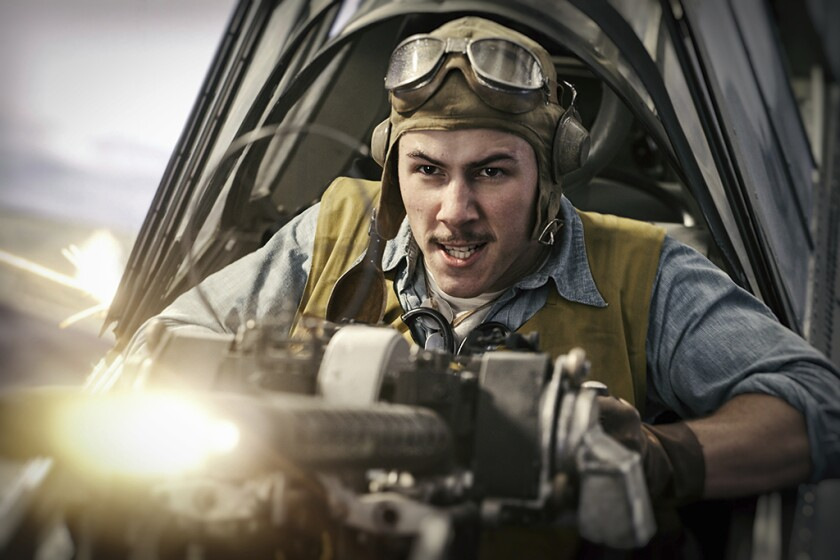"This image released by Lionsgate shows Nick Jonas in a scene from ""Midway."" (Reiner Bajo/Lionsgate via AP)"
