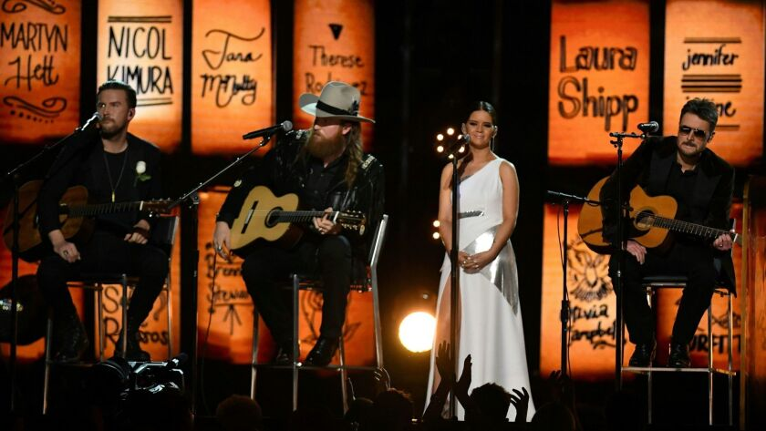 The Brothers Osborne, Maren Morris and Eric Church honored the Las Vegas and Manchester victims during their performance at the 60th Grammy Awards.