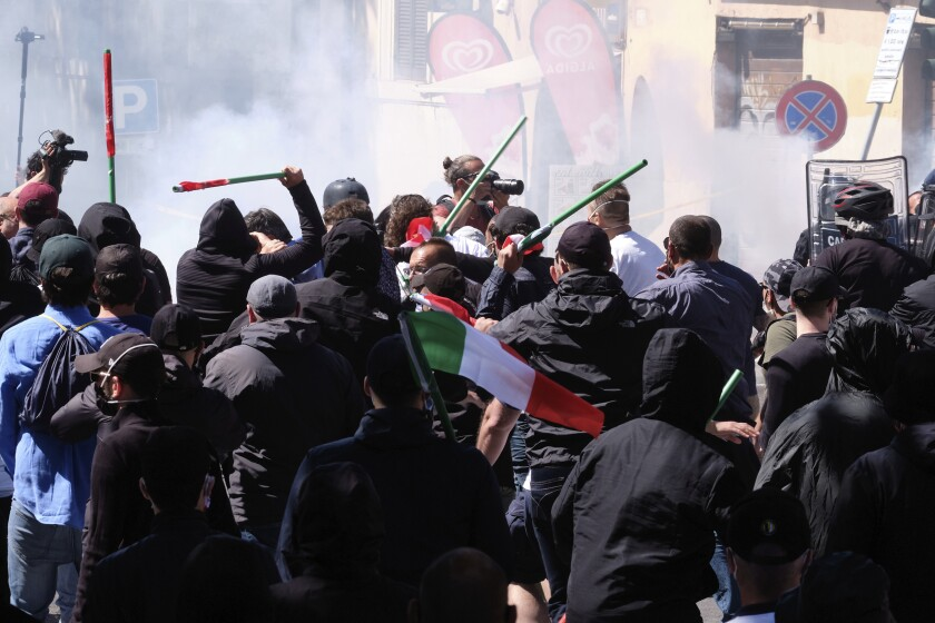 Right-wing supporters face police during a demonstration against the government in Rome, Saturday, June 6, 2020. (Mauro Scrobogna/LaPresse via AP)
