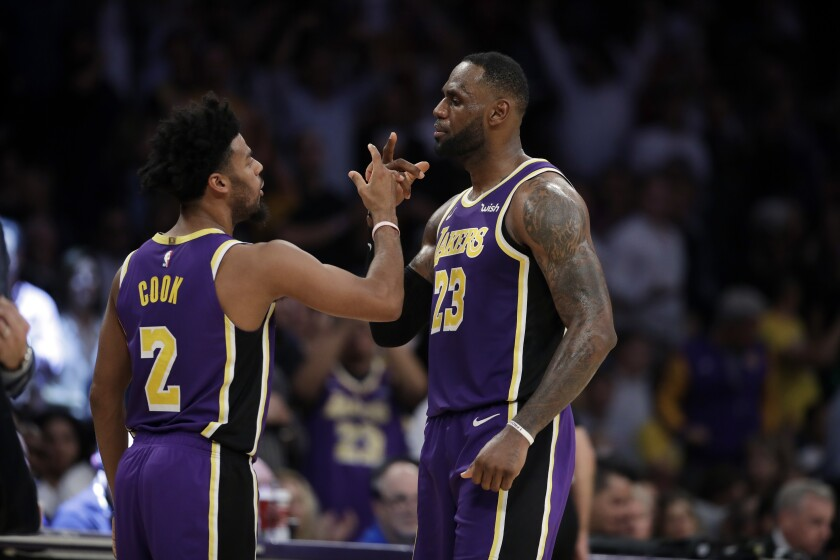 Lakers forward LeBron James celebrates with teammate Quinn Cook