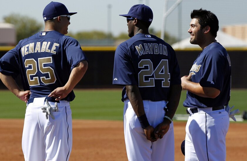 Carlos Quentin (right) stands with fellow Padres outfielders Will Venable and Cameron Maybin at spring training in Peoria, Ariz., on Saturday. Quentin was acquired in the offseason from the Chicago White Sox. K.C. Alfred • U-T