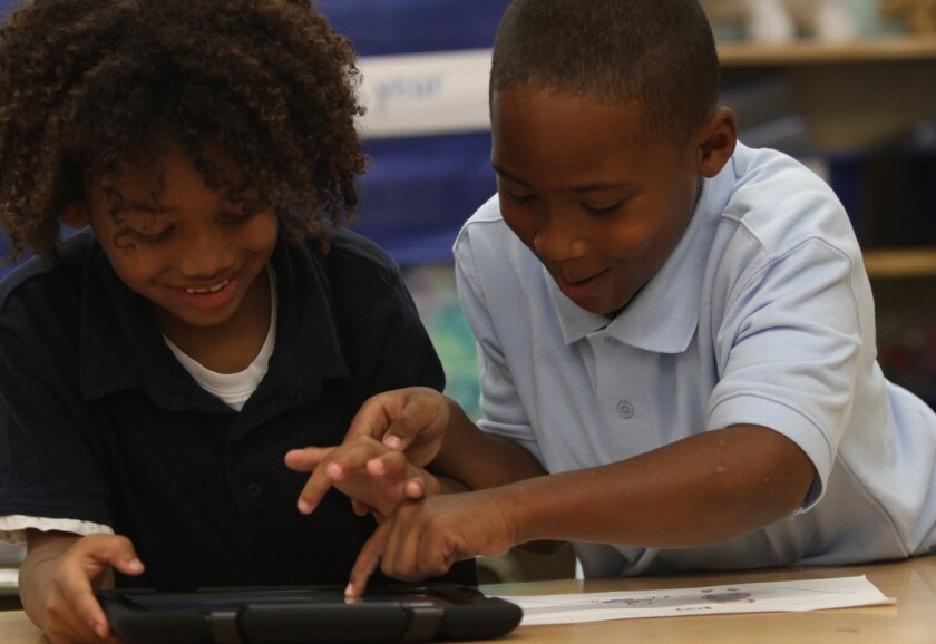 King Shelton, left, and Zylan Giles work with their new iPads at Broadacres Avenue Elementary School in Carson.
