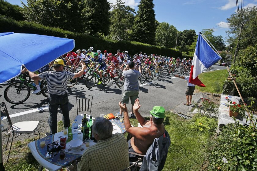 Spectators cheer as the pack passes during the fifth stage of the Tour de France cycling race over 216 kilometers (134.2 miles) with start in Limoges and finish in Le Lioran, France, Wednesday, July 6, 2016. (AP Photo/Christophe Ena)