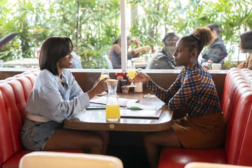 """Yvonne Orji, left, and Issa Rae in HBO's """"Insecure,"""" which will take home the comedy award at the AAFCA TV Honors on Aug. 22."""