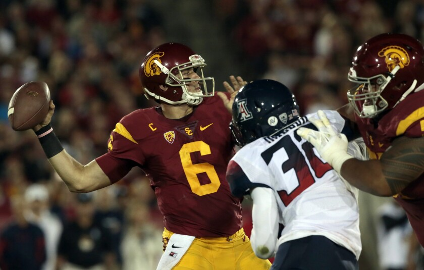 USC quarterback Cody Kessler connects with receiver Juju Smith-Schuster for a 72-yard touchdown pass against Arizona during a game at the Coliseum on Nov. 7.