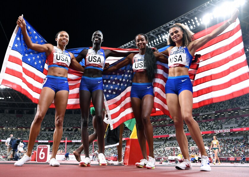 USA team members pose for photos after winning the gold medal.