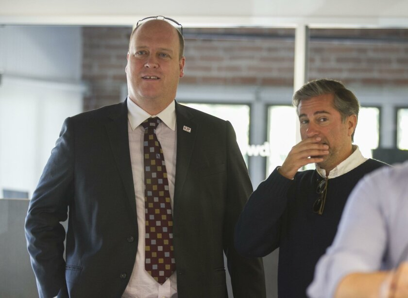 County GOP Chairman Tony Krvaric, left, and Jason Roe at a recent campaign event.