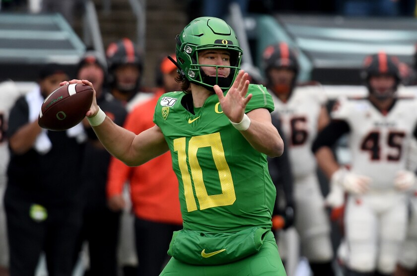 Oregon quarterback Justin Herbert was drafted No. 6 overall by the Chargers on Thursday.