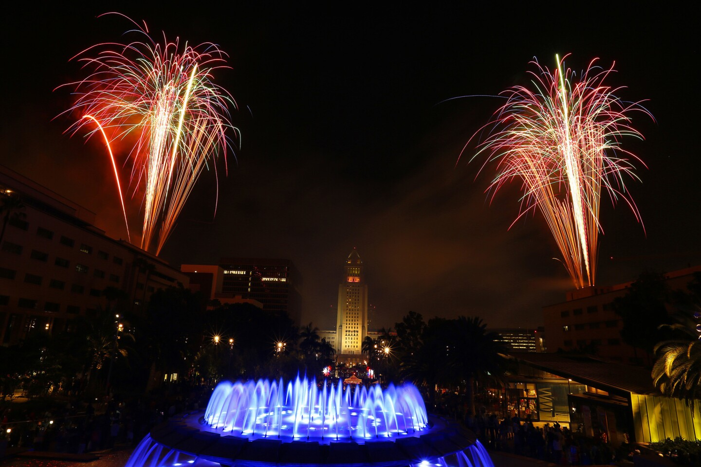 Fireworks light up the night around City Hall at the Grand Park Fourth of July Block Party in downtown Los Angeles.