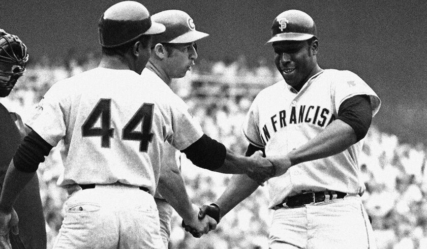 The Giants' Willie McCovey is congratulated after hitting one of his two home runs in the 1969 All-Star Game at Robert F. Kennedy Stadium in Washington, D.C.
