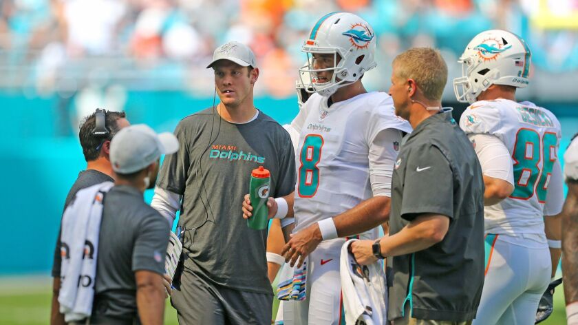 Dolphins quarterbacks Ryan Tannehill and Brock Osweiler (8) during the first quarter on Sunday.