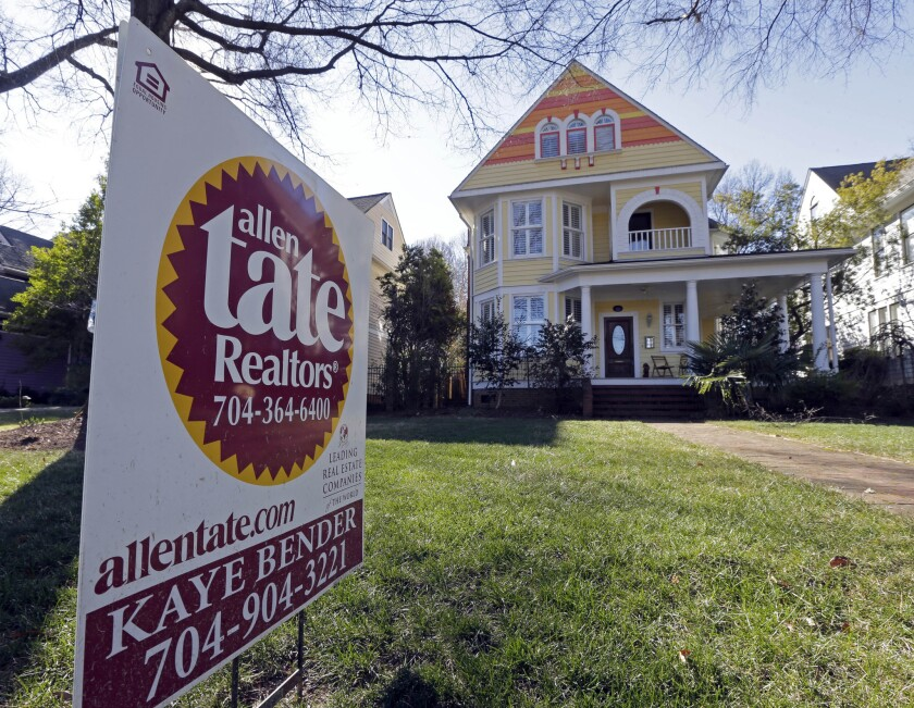 This Jan. 8, 2015, photo shows a home for sale in Charlotte, N.C. Fannie Mae and Freddie Mac are launching a program to back mortgages with down payments as low as 3%.