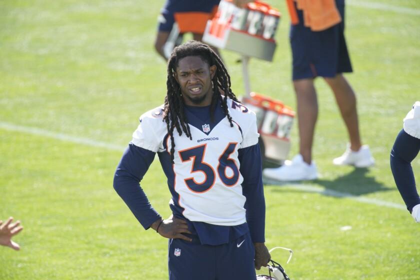 Denver Broncos defensive back Trey Marshall watches camp practice.
