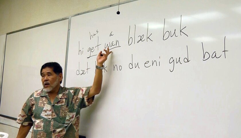 In this Feb. 5, 2016 photo, University of Hawaii at Manoa professor Kent Sakoda teaches a linguistics class on Pidgin in Honolulu. News reports on census data showing the number of Pidgin speakers in Hawaii have helped spark a sense of pride among those who speak the language in their homes.(AP Pho