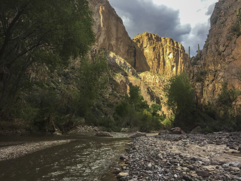 Aravaipa Creek flows through Aravaipa Canyon in Arizona.