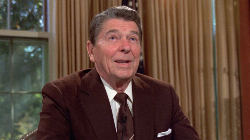Ronald Reagan is shown at his desk in the Oval Office of the White House in May of 1985, as he prepares a speech on tax revision.