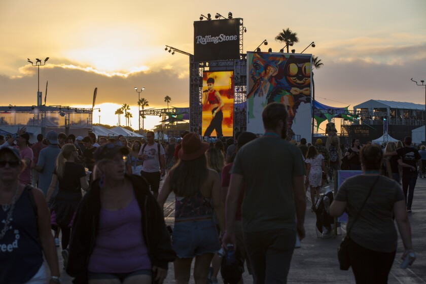 The sun sets over KAABOO Del Mar as attendees make their way towards the Sunset Cliffs Stage to watch Halsey perform on Friday, September 14th, 2018.