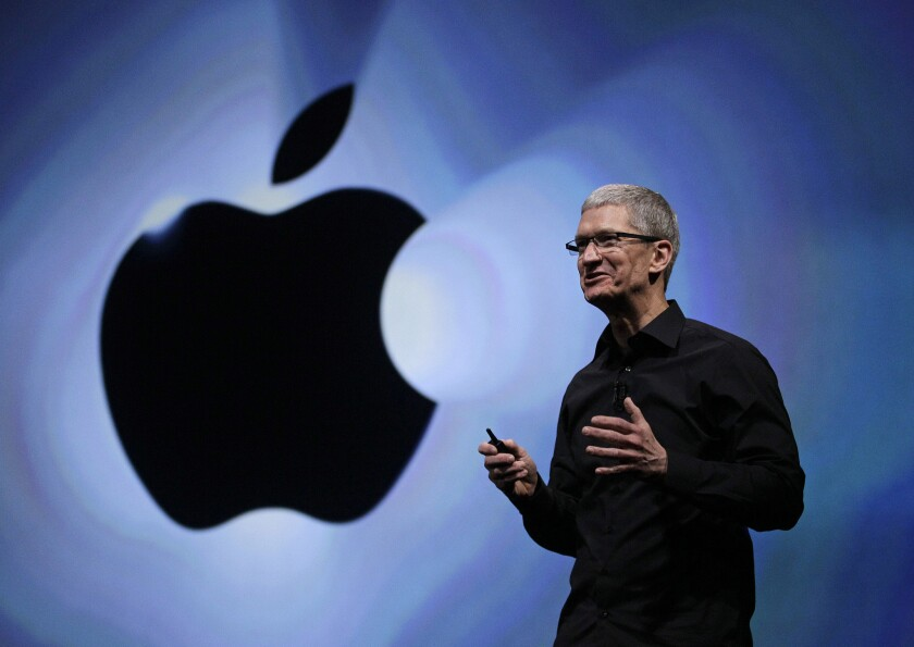 Apple CEO Tim Cook speaks at the introduction of the iPhone 5 in San Francisco in 2012. Apple has signed Sony Music to a streaming deal, setting the stage for an iRadio announcement on Monday.