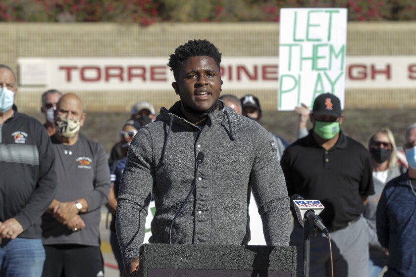 Westview High football player Mandela Tobin speaks during a sports rally Friday at Torrey Pines High.