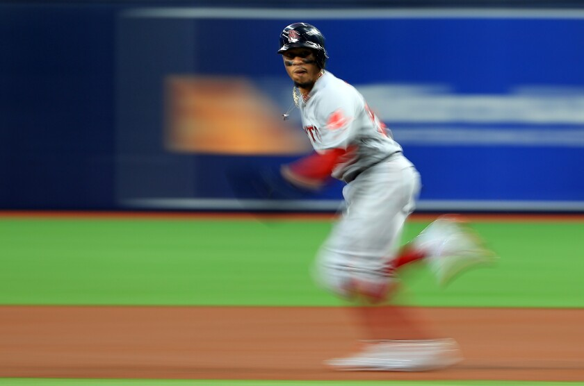 Boston Red Sox outfielder Mookie Betts steals second base against the Tampa Bay Rays on Sept. 23.