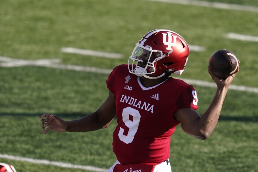 FILE - In this Oct. 24, 2020 file photo, Indiana quarterback Michael Penix Jr. (9) throws during the first half of an NCCAA college football game against Penn State in Bloomington, Ind. Indiana completed its most successful season since the late 1960s but fell short of reaching the Big Ten championship game, a goal they hope to achieve this season. (AP Photo/Darron Cummings, File)