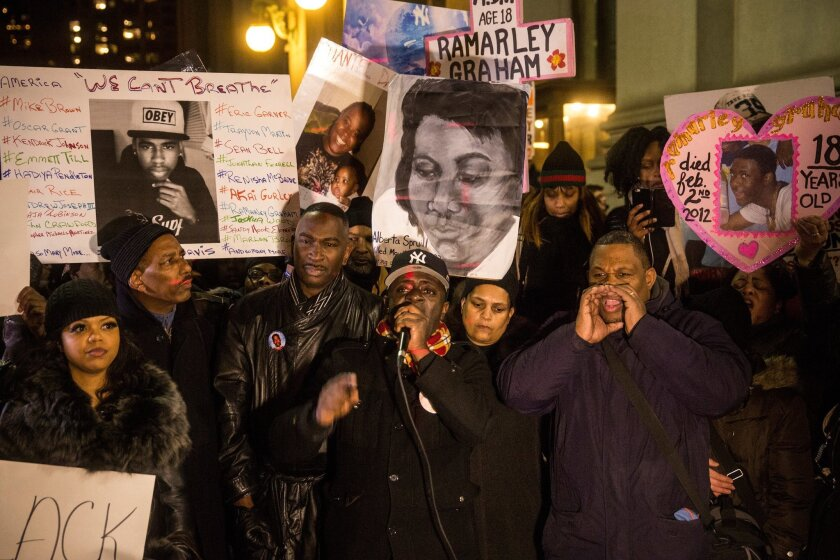 Frank Graham (C), father of Ramarley Graham, who was shot and killed by police officers in New York in 2012, speaks outside the New York Police Department Headquarters after marching in the National March Against Police Violence, which was organized by National Action Network.