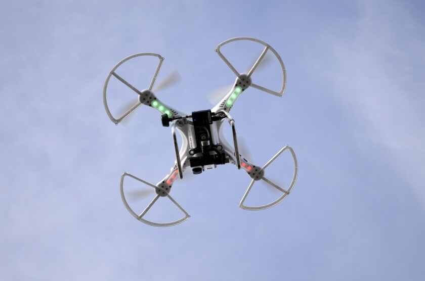 An aerial drone with a high-quality video camera records the landscape of the Berkshire Equestrian Center in Richmond, Mass. The California Assembly approved a bill Wednesday that would impose privacy restrictions on the use of drones by law enforcement and public agencies.