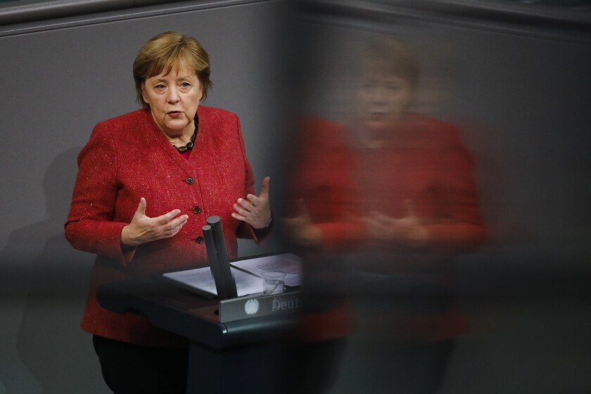 German Chancellor Angela Merkel delivers her speech during the debate about Germany's budget 2021, at the parliament Bundestag in Berlin, Germany, Wednesday, Dec. 9, 2020. (AP Photo/Markus Schreiber)