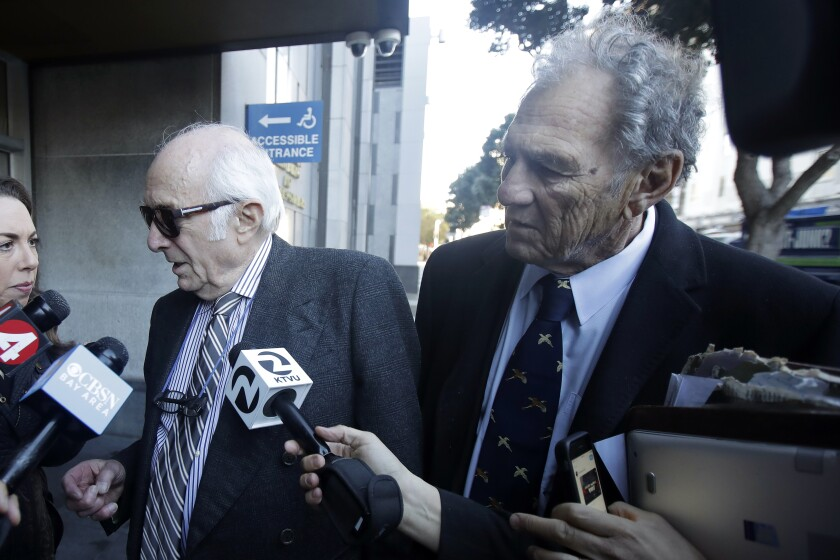 Attorneys Gil Eisenberg, left, and Michael Stepanian, both representing restaurateur Nick Bovis, speak to reporters outside of a federal courthouse in San Francisco, Thursday, Feb. 6, 2020. The FBI arrested public works director Mohammed Nuru and restaurateur Nick Bovis last week, saying the men schemed in 2018 to bribe a San Francisco airport commissioner for prime restaurant space at San Francisco International Airport. (AP Photo/Jeff Chiu)