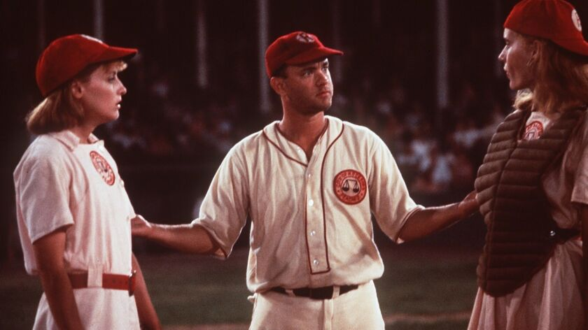 "Lori Petty (left), Tom Hanks (center) and Geena Davis (right) star in ""A League of Their Own."""
