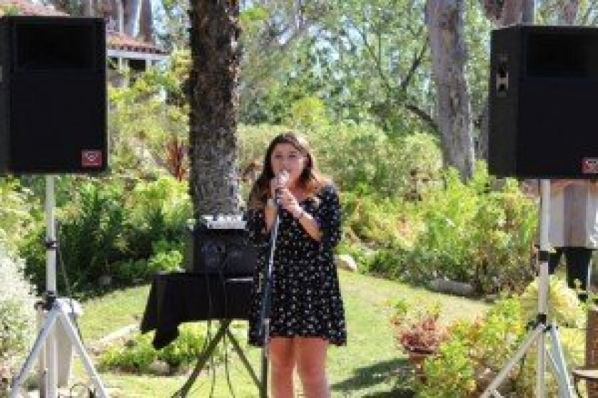 Singer Mattie Mangione entertained at the event.