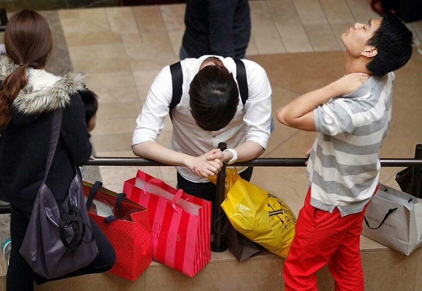 Shoppers at South Coast Plaza. In April, teen retailers and discounters did well while drug stores suffered.