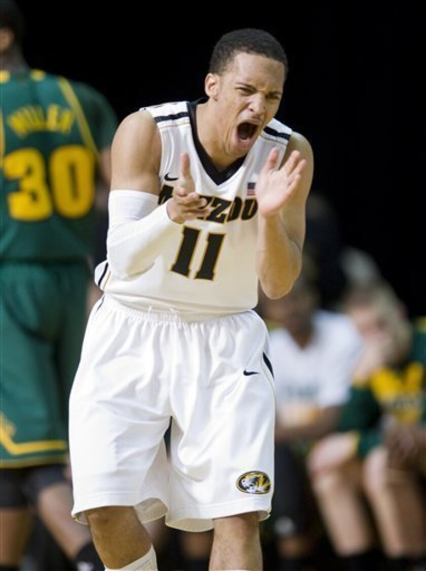 Missouri's Michael Dixon cheers after making a three-point shot during the second half of an NCAA college basketball game against Baylor, Saturday, Feb. 11, 2012, in Columbia, Mo. Missouri won the game 72-57. (AP Photo/L.G. Patterson)