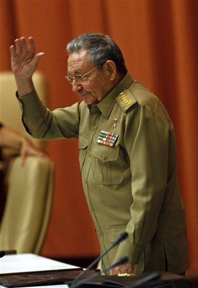 Cuba's President Raul Castro, greets members to parliament at the opening of the second day of a twice-annual legislative sessions, at the National Assembly in Havana, Cuba, Sunday, July 7, 2013. Observers will be watching to see if the new vice president is taking on increasing responsibility since assuming the post in what was seen as the beginning of a generational leadership transition. (AP Photo/Ismael Francisco, Cubadebate)