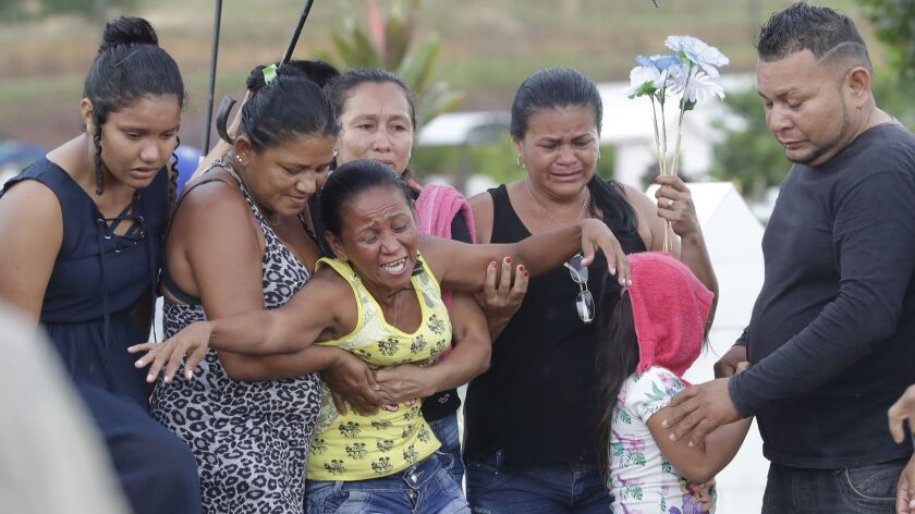 Antonia Alves grieves as she is comforted by relatives during the burial of her son Jairo Alves Figueiredo, an inmate who was killed in the recent prison riots, at a cemetery in Manaus, Brazil, on May 30, 2019.