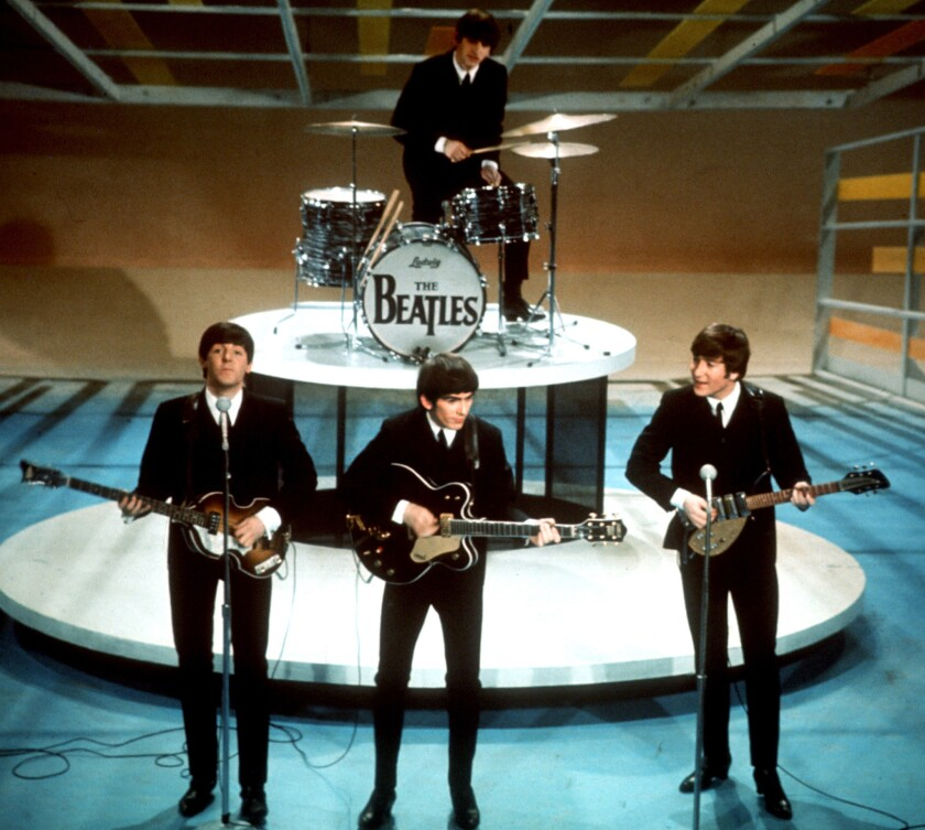 The Beatles, shown during their 1964 appearance on 'The Ed Sullivan Show,' were referenced in a federal judge's ruling on the National Security Agency's practice of gathering information from telecommunications providers.
