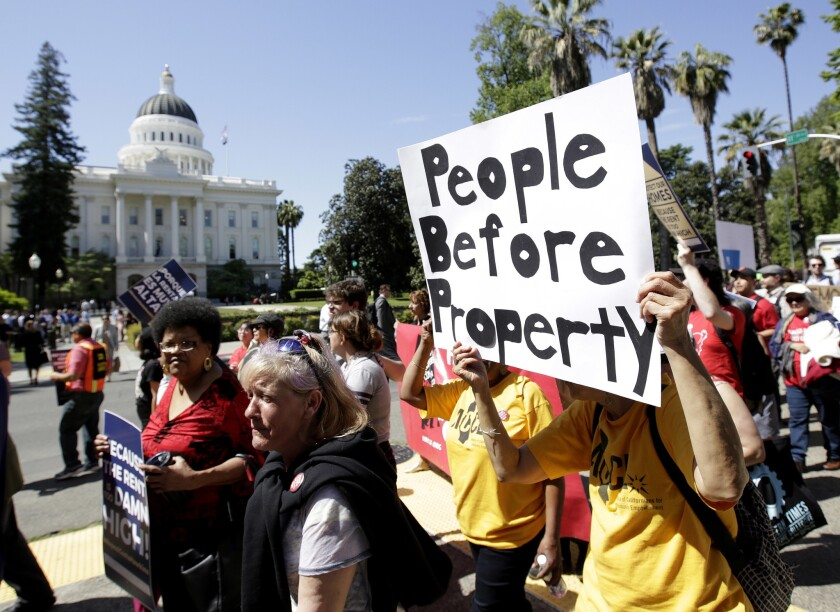 Supporters of a rent control initiative march near the Capitol in Sacramento in April 2018.