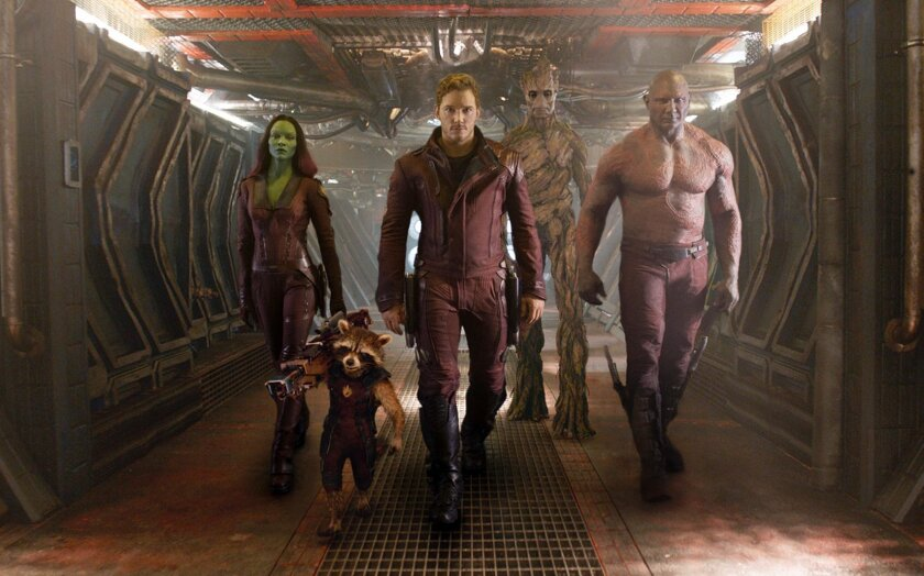 """This image released by Disney - Marvel shows, from left, Zoe Saldana, the character Rocket Racoon, voiced by Bradley Cooper, Chris Pratt, the character Groot, voiced by Vin Diesel and Dave Bautista in a scene from """"Guardians of the Galaxy."""" The movie releases on Friday, Aug. 1, 2014. (AP Photo/Disney - Marvel)"""