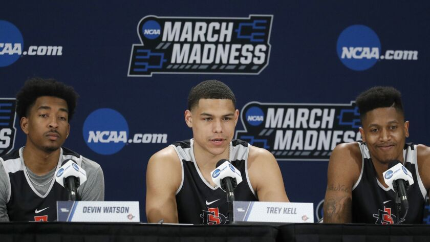 Devin Watson, left, Trey Kell, center, and Malik Pope speak Wednesday during an NCAA Tournament press conference at Intrust Bank Arena in Wichita, Kan. They are three of five players averaging double figures for the Aztecs.