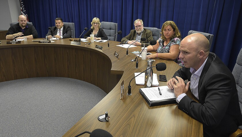 Burbank Unified School district Board of Education members listen to Superintendent Matt Hill as the