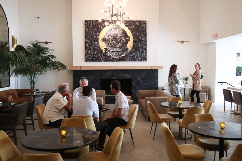 Guests enjoy the new surroundings in the lounge of the newly renovated restaurant and lobby at the Hotel Laguna.