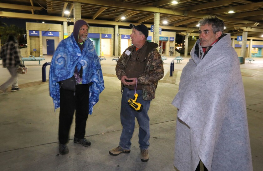 During a Jan. 27 homeless count Oceanside, Councilman Jerry Kern, middle, speaks to homeless veterans Michael Entzel, left, and Jerome Burch, at right, at the Oceanside Transit Center.